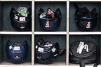Cal State Fullerton helmet rack on June 15, 2015 at TD Ameritrade Park in Omaha, Nebraska. Vanderbilt beat Cal State Fullerton 4-3. (Andrew Woolley/Four Seam Images)