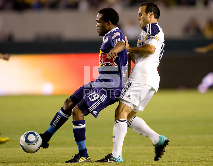 Dane Richards of the York Red Bulls moves with the ball as LA Galaxy midfielder Landon Donovan defends. The New York Red Bulls beat the LA Galaxy 2-0 at Home Depot Center stadium in Carson, California on Friday September 24, 2010.