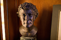A bust of Irish poet Seamus Heaney stands on a shelf in the Irish Room in the Honorable John J. Burns Library at Boston College's Chestnut Hill, Massachusetts, campus on Tues., Dec. 17, 2013. Heaney won the Nobel prize for literature in 1995. Heaney sat for the bust by Lyn Kramer of London in 1980.