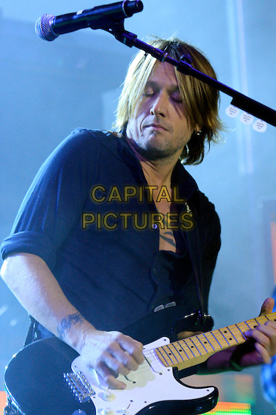 KEITH URBAN.Keith Urban surprises fans onstage with Darius Rucker at the Capitol Street Party, Nashville, TN, USA..October 13th, 2010.stage concert live gig performance music half length shirt guitar black stubble facial hair .CAP/ADM/RR.©Randi Radcliff/AdMedia/Capital Pictures.