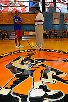 30 September, 2010, Kansas City, Kansas USA.Wayne Simien and Brad Daugherty meet at center court, The College Basketball Experience..©2010, F. Peirce Williams, USA.