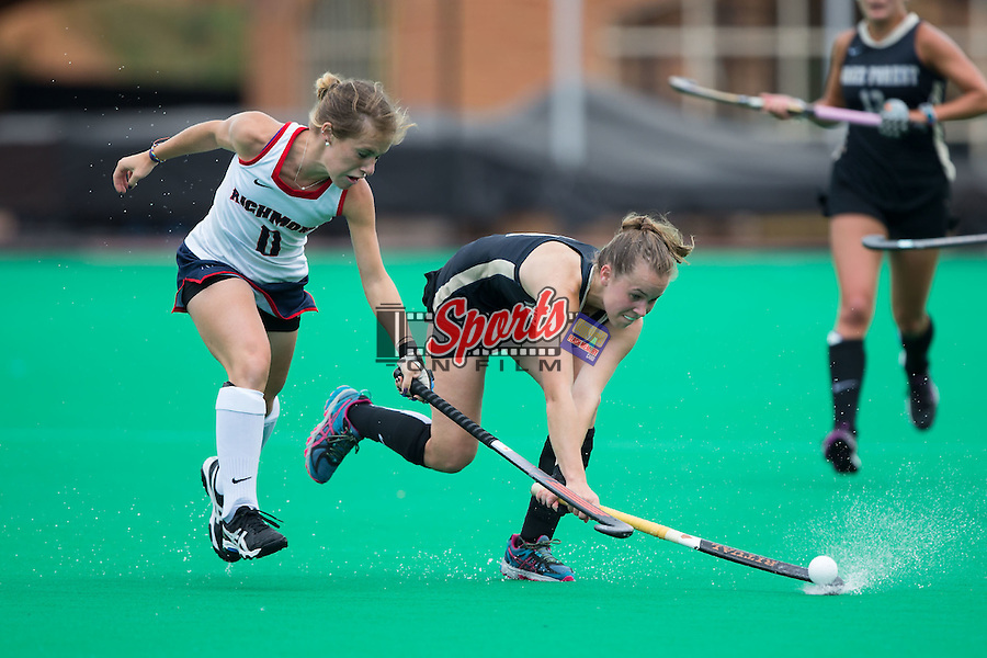 Megan Anderson (23) of the Wake Forest Demon Deacons passes the ball away from Megan Miller (0) of the Richmond Spiders during second half action at Kentner Stadium on September 13, 2015 in Winston-Salem, North Carolina.  The Demon Deacons defeated the Spiders 6-1.  (Brian Westerholt/Sports On Film)