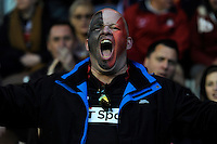 An Edinburgh Rugby fan enjoys the action early in the match