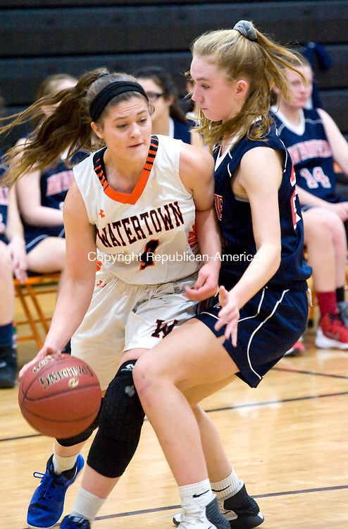 WATERTOWN, CT-011118JS04---Watertown's Kayla Fac (4) gets fouled by New Fairfield's Kerrigan Quinn (24) as she drives to the basket during their non-league game Thursday at Watertown High School.<br />  Jim Shannon Republican-American