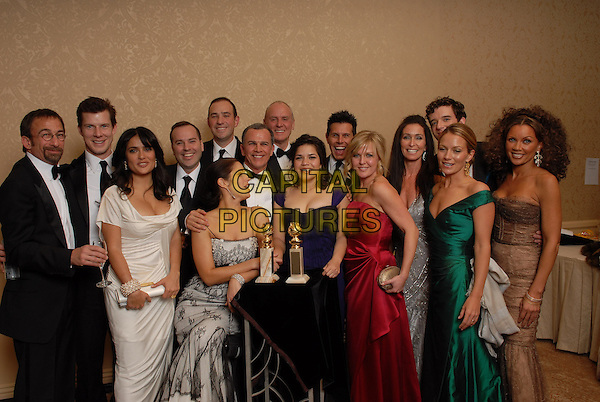 """CAST & CREW OF """"UGLY BETTY"""".Winner of Best Performance by an Actress in a Television Series - Musical or Comedy award for """"Ugly Betty"""".Pressroom - 64th Annual Golden Globe Awards, Beverly Hills HIlton, Beverly Hills, California, USA..January 15th 2007. .globes press room full length purple dress award trophy Vanessa L. Willams, America Ferrera, Salma Hayek Ashley Jensen white red silver grey gray studio.CAP/AW.Please use accompanying story.Supplied by Capital Pictures.© HFPA"""" and """"64th Golden Globe Awards"""""""