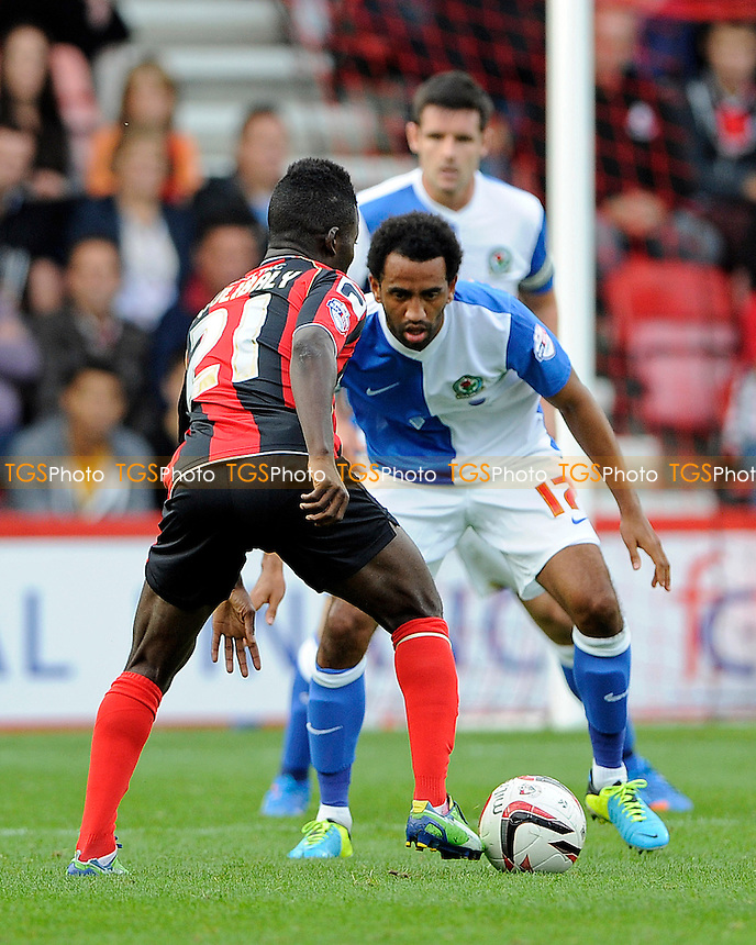 Lee Williamson of Blackburn Rovers defends against Mohamed Coulibaly of AFC Bournemouth - AFC Bournemouth vs Blackburn Rovers - Sky Bet Championship Football at the Goldsands Stadium, Bournemouth, Dorset - 28/09/13 - MANDATORY CREDIT: Denis Murphy/TGSPHOTO - Self billing applies where appropriate - 0845 094 6026 - contact@tgsphoto.co.uk - NO UNPAID USE
