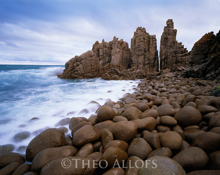 Australia, Victoria, Phillip Island, Cape Wollamai, rocky outcrops and pebbly shore of cape in stormy weather
