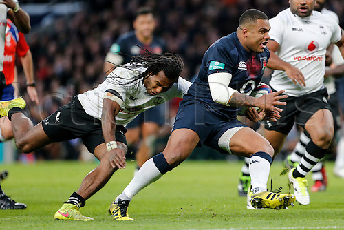 19.11.2016. Twickenham, London, England. Autumn International Rugby. England versus Fiji.  Kyle Sinckler of England is tackled by Albert Vulivuli of Fiji.   Final score: England 58-15 Fiji.
