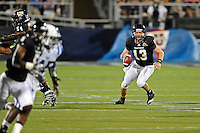 1 October 2011:  FIU quarterback Wesley Carroll (13) looks for a receiver downfield while scrambling in the second quarter as the Duke University Blue Devils defeated the FIU Golden Panthers, 31-27, at FIU Stadium in Miami, Florida.