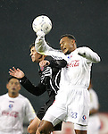 01 March 2007: Olimpia's Sergio Mendoza (23) gets an arm up against a DC United challenge. DC United defeated CD Olimpia of Honduras 3-2 at RFK Stadium in Washington DC in the second leg of a CONCACAF Champions Cup quarterfinal competition.  DC United advanced by an aggregate score of 7-3.
