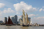 London, UK. 9 September 2014. Tall ships near Canary Wharf. The Tall Ships that have taken part in the Royal Greenwich Tall Ships Festival 2014 leave Greenwich in a Parade of Sail down the River Thames.