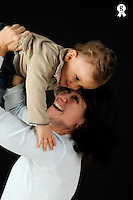 Happy mother holding up baby boy (1) (Licence this image exclusively with Getty: http://www.gettyimages.com/detail/84869052 )