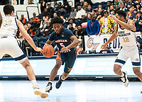 Sherwyn Devonish #5 of Morgan State moves between Javier Langarica #32 and Jameer Nelson Jr. #12 of George Washington