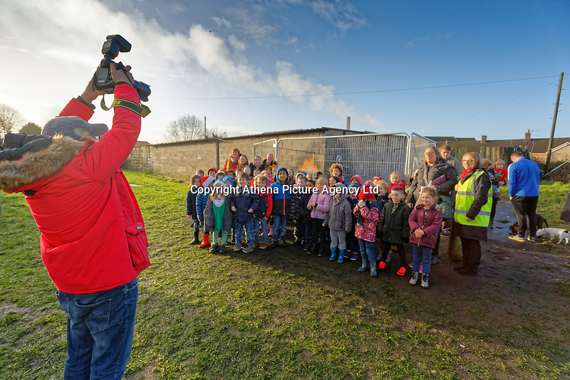 "Pictured: A group of school children visit the Banksy graffiti on a garage in Port Talbot, Wales, UK. Thursday 20 December 2018<br /> Re: The artist Banksy has confirmed that a new graffiti piece that has appeared in Port Talbot, south Wales is his.<br /> He announced on Instagram: ""Season's greetings"" - with a video of the artwork in the Taibach area of Port Talbot.<br /> The image appears on two sides of a garage in a lane near Caradog Street, depicting a child enjoying snow falling - the other side reveals it is a fire emitting ash.<br /> The owner of the garage said he had not slept over fears it might be vandalised."