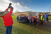 Pictured: A group of school children visit the Banksy graffiti on a garage in Port Talbot, Wales, UK. Thursday 20 December 2018<br /> Re: The artist Banksy has confirmed that a new graffiti piece that has appeared in Port Talbot, south Wales is his.<br /> He announced on Instagram: &quot;Season's greetings&quot; - with a video of the artwork in the Taibach area of Port Talbot.<br /> The image appears on two sides of a garage in a lane near Caradog Street, depicting a child enjoying snow falling - the other side reveals it is a fire emitting ash.<br /> The owner of the garage said he had not slept over fears it might be vandalised.