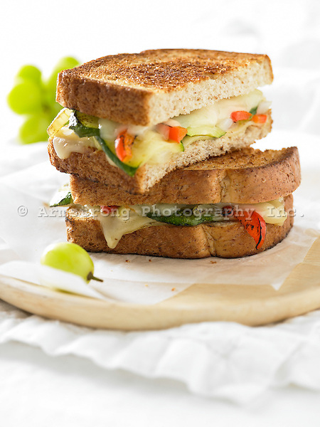 Toasted vegetable and cheese sandwich, with green grapes