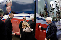 Former Speaker of the House Newt Gingrich returns to his campaign bus after a stop in Littleton, New Hampshire.  Gingrich is seeking the 2012 Republican nomination for president.
