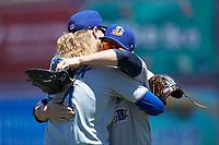 Durham Bulls relief pitcher Ryne Stanek (left) hugs teammate Jake Bauers (right) prior to the game against the Lehigh Valley Iron Pigs at Coca-Cola Park on July 30, 2017 in Allentown, Pennsylvania.  The Bulls defeated the IronPigs 8-2.  (Brian Westerholt/Four Seam Images)