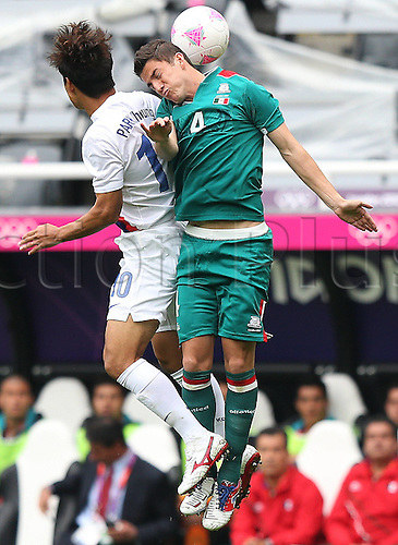 26.07.2012. Newcastle, England.  Hiram Mier of Mexico Heads The Ball during The Preliminary Round Group B Match of Men s Football between South Korea and Mexico in Newcastle The Game Ended in A 0 0 Draw