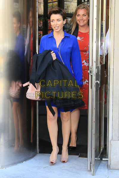 Dannii Minogue leaving Vogue House,.London, England..September 18th, 2012.full length blue dress beige peep toe shoes carrying black coat door.CAP/HIL.©John Hillcoat/Capital Pictures.