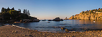 Taormina, panoramic photo of Isola Bella Beach in the first morning light, Sicily, Italy, Europe. This is a panoramic photo of Isola Bella Beach in the first morning light at Taormina, Sicily, Italy, Europe.