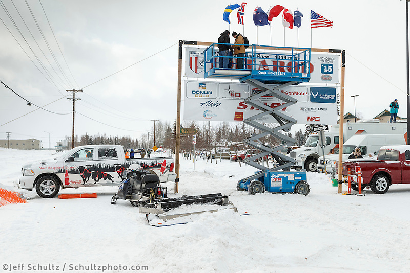 Volunteers set up the start banner outside Pike's Waterfront Lodge in Fairbanks on Sunday March 8, 2015 the day before the official start of Iditarod 2015<br /> <br /> (C) Jeff Schultz/SchultzPhoto.com - ALL RIGHTS RESERVED<br />  DUPLICATION  PROHIBITED  WITHOUT  PERMISSION