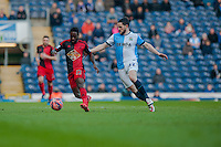 BLACKBURN, ENGLAND - JANUARY 24:  Nathan Dyer of Swansea City and Craig Conway of Blackburn Rovers chase the ball  during the FA Cup Fourth Round match between Blackburn Rovers and Swansea City at Ewood park on January 24, 2015 in Blackburn, England.  (Photo by Athena Pictures/Getty Images)