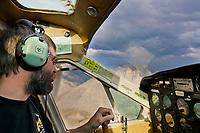 Bush pilot dirk nickisch of coyote air, flies over the Arctic National Wildlife Refuge, Brooks Range mountains, Alaska.