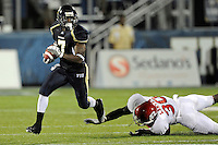 11 September 2010:  FIU cornerback Anthony Gaitor (7) evades Rutgers fullback Edmond Laryea (30) while returning an interception 27 yards in the fourth quarter as the Rutgers Scarlet Knights defeated the FIU Golden Panthers, 19-14, at FIU Stadium in Miami, Florida.