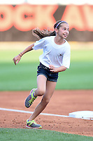 Young girl participates in the Buffalo Bisons on field promotion, the base race, during a game against the Pawtucket Red Sox on August 26, 2014 at Coca-Cola Field in Buffalo, New  York.  Pawtucket defeated Buffalo 9-3.  (Mike Janes/Four Seam Images)