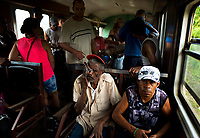 HAVANA, CUBA - OCTOBER 29: Cubans travel from Havana to Matanzas during a trip on the electronic Hersey train on October 29, 2015 in Cuba. Ferrocarriles de Cuba, is one of the oldest railroad around world, having opened its first route in 1837 with at least 17-mile long. Now the railway probably could cover more than 2,600 miles along the Island. (Photo by Eliana Aponte/VIEWpress)