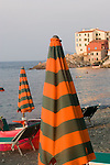 Beach umbrellas, Mariana Marina, Italian coastal town beach, Elba; Tuscan Archipelago, Italy, Mediterranean Sea;
