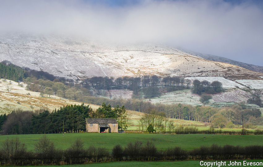 Stone barn in front of Bowland fells with snow, Dunsop Bridge, Lancashire.