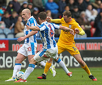 Preston North End's Aidan McGeady is tackled by Huddersfield Town's Aaron Mooy and Jonathan Hogg<br /> <br /> Photographer Alex Dodd/CameraSport<br /> <br /> The EFL Sky Bet Championship - Huddersfield Town v Preston North End - Friday 14th April 2016 - The John Smith's Stadium - Huddersfield<br /> <br /> World Copyright &copy; 2017 CameraSport. All rights reserved. 43 Linden Ave. Countesthorpe. Leicester. England. LE8 5PG - Tel: +44 (0) 116 277 4147 - admin@camerasport.com - www.camerasport.com
