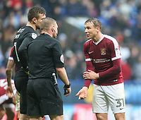 Northampton Town's Matthew Taylor pleads his innocence after referee Richard Clark awarded a penalty to Bolton Wanderers<br /> <br /> Photographer Alex Dodd/CameraSport<br /> <br /> The EFL Sky Bet League One - Bolton Wanderers v Northampton Town - Saturday 18th March 2017 - Macron Stadium - Bolton<br /> <br /> World Copyright &copy; 2017 CameraSport. All rights reserved. 43 Linden Ave. Countesthorpe. Leicester. England. LE8 5PG - Tel: +44 (0) 116 277 4147 - admin@camerasport.com - www.camerasport.com