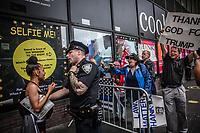 NEW YORK, USA - August 23 : Pro Trump and anti Trump demonstrators are seen screaming slogans to each other in a protest to demand Greyhound collaboration with ICE on August 23, 2019 in New York, USA.<br /> Everyday across the U.S., ICE, DHS and Border Patrol agents board buses with Greyhound's permission and attempt to detain migrants. Demonstrators at the Port Authority bus terminal demand Greyhound to end all collaboration with ICE and Border Patrol. <br /> (Photo by Luis Boza/VIEWpress)