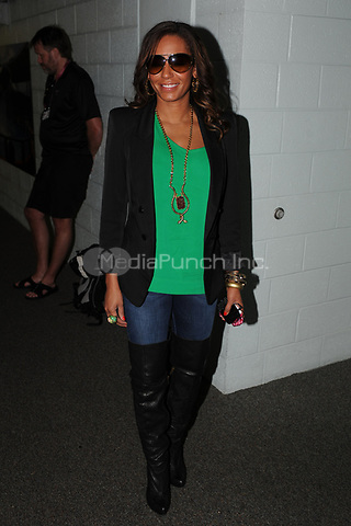 Orig pix taken - on March 23, 2010 in Key Biscayne, Florida.<br /> <br />MIAMI BEACH, FL- AUGUST 29:  (www.mirror.co.uk)   Spice Girl Mel B&rsquo;s three-year marriage is FINISHED, her husband Stephen Belafonte has revealed. The film producer told me in an emotional telephone outburst from the States: &ldquo;Dude, it&rsquo;s over. Mel&rsquo;s coming back to the UK soon &ndash; but I won&rsquo;t be coming with her.&rdquo; And I can reveal he has talked to lawyers in Los Angeles about a divorce from Scary Spice Mel.<br />The couple wed in 2007 just six months after Mel&rsquo;s bitter split from actor Eddie Murphy &ndash; dad of her daughter Angel, three. Only days ago the couple, both 35, were photographed kissing over lunch, and Mel has posted Twitter updates referring to her &ldquo;hubby&rdquo;.<br />But pals have said for months that the pair&rsquo;s rollercoaster relationship was finally hitting the rocks.<br />And now Belafonte admits ?divorce is on the way. He told me: &ldquo;There&rsquo;s been problems lately. I don&rsquo;t know what&rsquo;s happening.&rdquo;<br />A friend of Mel said: &ldquo;They&rsquo;ve not been happy for a long time and there&rsquo;s been rowing.<br /><br /><br />&ldquo;Mel&rsquo;s been talking about getting out. They&rsquo;re still talking to see if things can be worked out.<br />&ldquo;But she&rsquo;s making plans to come back to the UK on a more ?permanent basis. Stephen hasn&rsquo;t been ?mentioned as joining her and has been consulting lawyers.&rdquo;<br />When the couple wed in Las Vegas Mel&rsquo;s mother Andrea called it a &ldquo;big mistake&rdquo;. Just weeks later it emerged Stephen had attacked his ex Nicole Contreras &ndash; mum of his daughter Giselle, six &ndash; in 2003. Mel and Belafonte will have to decide what to do about access to each other&rsquo;s children &ndash; Mel also has daughter Phoenix, 11, from her first marriage to dancer Jimmy Gulzar.<br />Ironically, US TV viewers will next week see the family together when 