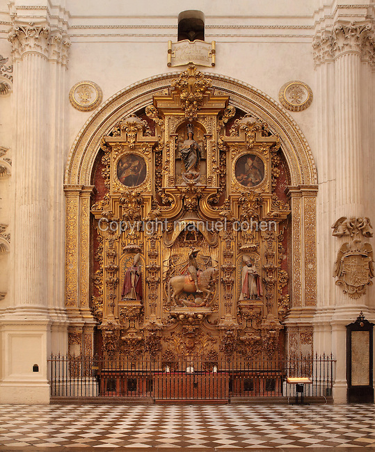 The Triunfo de Santiago altarpiece, made 1707-8 by Francisco Hurtado Izquierdo, 1669-1725, in Granada Cathedral, or the Cathedral of the Incarnation, built 16th and 17th centuries in Renaissance style with Baroque elements, Granada, Andalusia, Southern Spain. The altarpiece includes the Virgin of the Immaculate Conception by Jose Risueno and an equestrian statue of St James by Alonso de Mena, 1587-1646. Several architects worked on the cathedral, which, unusually, has 5 naves and a circular capilla mayor instead of an apse. Granada was listed as a UNESCO World Heritage Site in 1984. Picture by Manuel Cohen