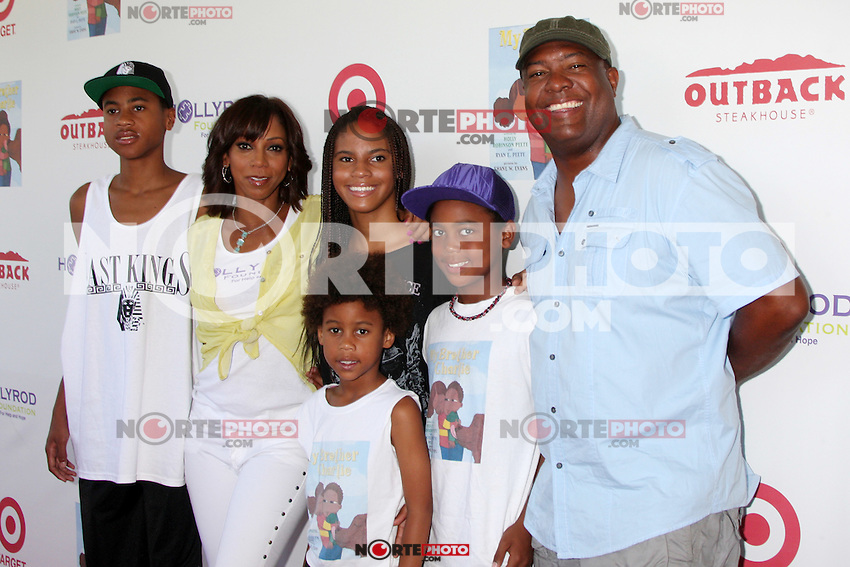 CULVER CITY, CA - AUGUST 12:  Holly Robinson Peete and Rodney Peete at the 3rd Annual My Brother Charlie Family Fun Festival at Culver Studios on August 12, 2012 in Culver City, California.  Credit: mpi26/MediaPunch Inc.