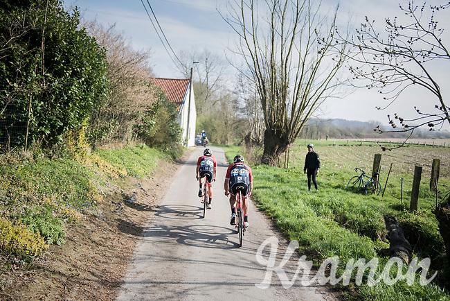 teammates Marco Coledan (ITA/Trek-Segafredo) &amp; Fumy Beppu (JAP/Trek-Segafredo) chasing on the narrow belgian farm roads<br /> <br /> 60th E3 Harelbeke (1.UWT)<br /> 1day race: Harelbeke &rsaquo; Harelbeke - BEL (206km)