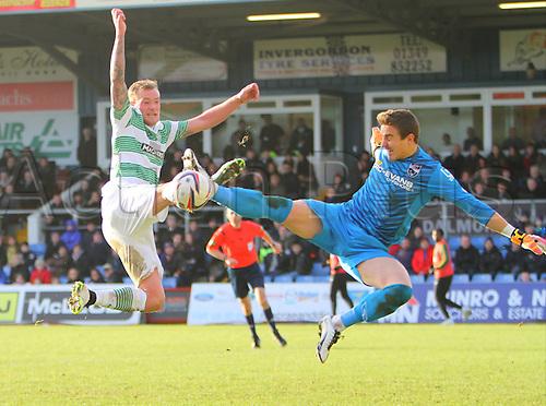 24.01.2015.  Dingwall, Scotland. Scottish Premier League. Ross County versus Celtic. Antonio Reguero and John Guidetti jump into a challenge