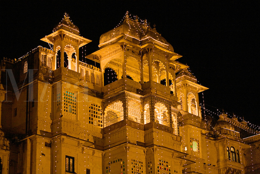 Night view of the CITY PALACE of UDAIPUR which was originally built by Maharaja Udai Singh ll in 1600 AD  - RAJASTHAN, INDIA