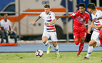 GEORGETOWN, GRAND CAYMAN, CAYMAN ISLANDS - NOVEMBER 19: Paul Arriola #7 of the United States is chased down by Jose Perez #11 of Cuba during a game between Cuba and USMNT at Truman Bodden Sports Complex on November 19, 2019 in Georgetown, Grand Cayman.