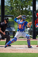 GCL Mets catcher Nelson Mompierre (9) throws to second base in front of home plate umpire Ryne Sigmon during a game against the GCL Nationals on August 4, 2018 at FITTEAM Ballpark of the Palm Beaches in West Palm Beach, Florida.  GCL Nationals defeated GCL Mets 7-4.  (Mike Janes/Four Seam Images)