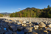 Black Mountain from the along the East Branch of the Pemigewasset River in Lincoln, New Hampshire during the autumn months. The bridge on the left is the main entrance to the Loon Mountain Ski area.
