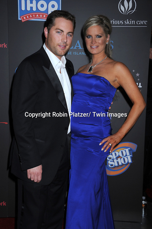 Jay McGraw and wife  arriving at the 38th Annual Daytime Emmy Awards  on June 19, 2011 at The Las Vegas Hilton in Las Vegas Nevada. ..