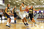 SIOUX FALLS, SD - JANUARY 2:  Amber Paden #42 from the University of Sioux Falls drives to the basket between Logan O'Farrell #30, Nicole Kerkhoff #32 and Paige Peterson #23 from Augustana in the first half of their game Friday night at the Stewart Center. (Photo by Dave Eggen/Inertia)