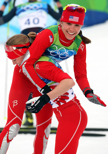 USA's Elizabeth Stephen lifts teammate Morgan Arritola  following their finish in the women's cross country 10k individual freestyle at the XXI Olympic Winter Games Monday, February 15, 2008 at Whistler Olympic Park in Whistler, British Columbia.