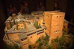 People viewing model of Alcazar fortress, Torre de la Calahorra museum, Cordoba, Spain