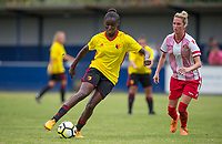 Rinsola Babajide of Watford Ladies moves from Tanya Blacksley of Stevenage Ladies during the pre season friendly match between Stevenage Ladies FC and Watford Ladies at The County Ground, Letchworth Garden City, England on 16 July 2017. Photo by Andy Rowland / PRiME Media Images.